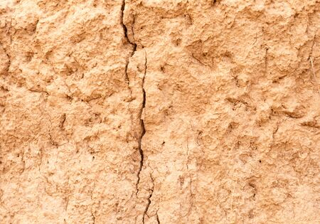 mud wall: Riverbank to the dry ground.