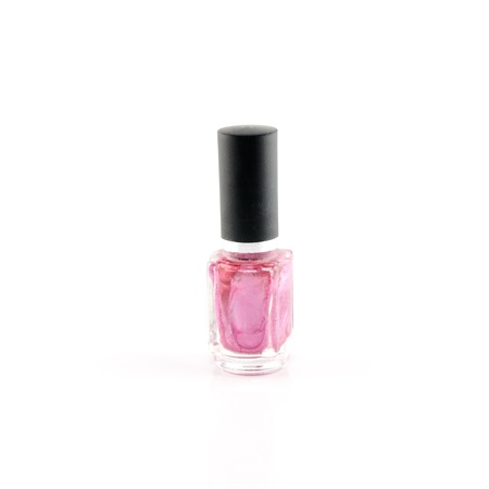 Bottle of purple nail polish on a white background  photo