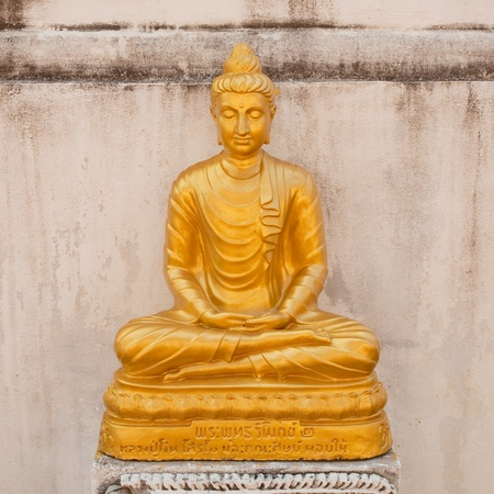 Yellow Buddha at Wat Phrae Thailand Sogemen  Stock Photo