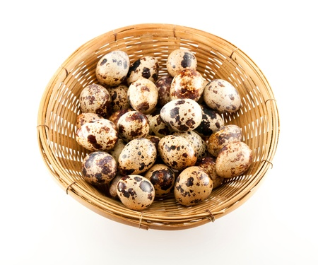 Quail eggs from a white background