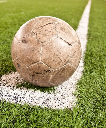 Old soccer ball  Artificial turf