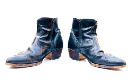 Boots in black on a white background. Stock Photo - 13024600