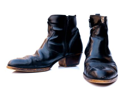 Boots in black on a white background.  photo