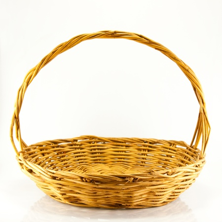 Woven wicker basket on a white background.  Stock Photo