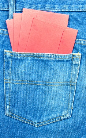 Red envelope in your pocket flare jeans. photo