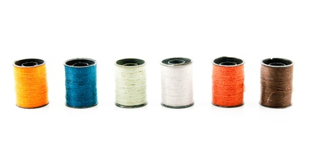 Spinning yarn in various colors on a white background  photo