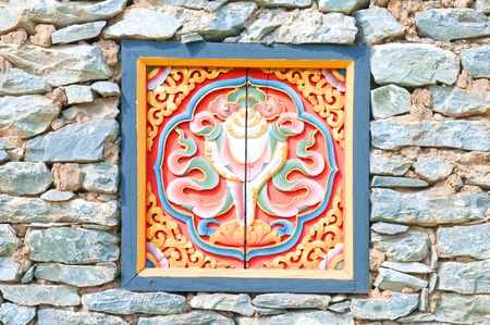 The wood carvings on the stone wall  photo
