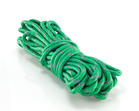 string together: Green rope isolated on a white background  Stock Photo