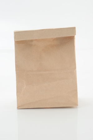 Brown paper bag from a white background