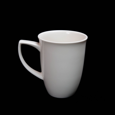 White ceramic cup isolated black background