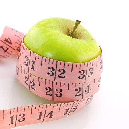 Pink measuring tape around apple green to represent the Lodge Restaurant  Stock Photo