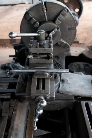 steel lathe lathe turning machine isolated on white background stock photo