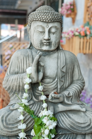 Buddha statue with plaster. Stock Photo