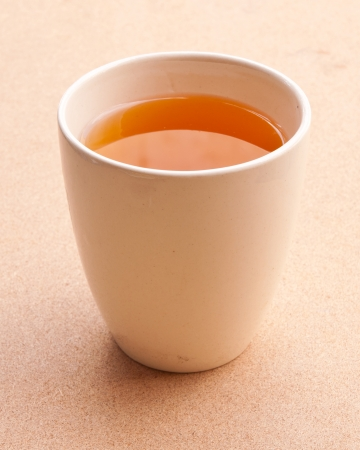 White tea cup on the floor. Stock Photo