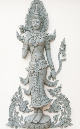 Angels on the walls are decorated in a Thai temple in Thailand. Stock Photo