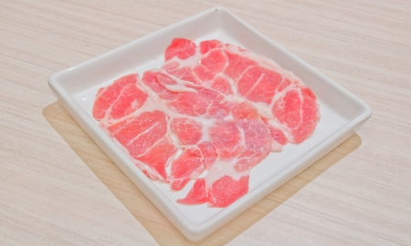 Separate raw meat sliced on a plate. photo
