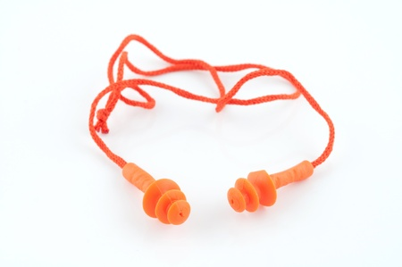 orange earplug to reduce noise on a white background photo
