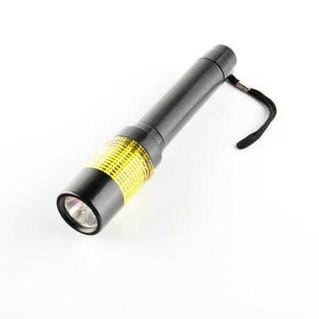 switched: LED flashlight switched on, isolated on white Stock Photo