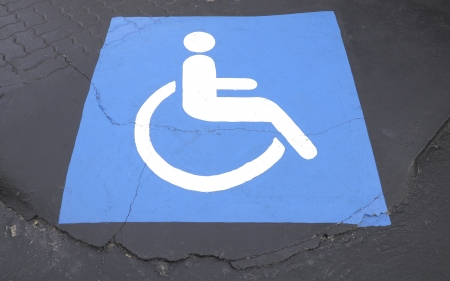 Handicapped symbol on the ground. Stock Photo - 20970668