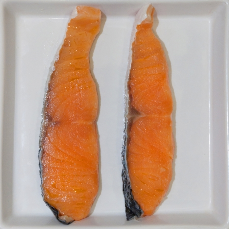 Salmon on white dish. photo