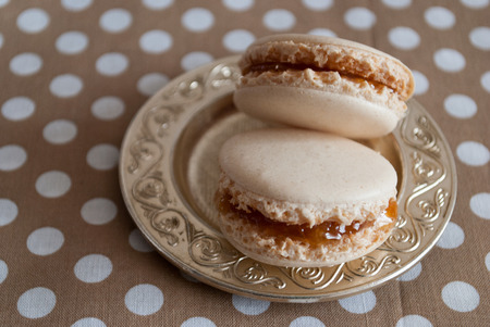 macarons: French dessert - macarons with apricot cream