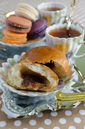 french pastry: French pastry macarons - orange, passion fruit, chocolate, vanilla, raspberry, bergamot, black currant and bun