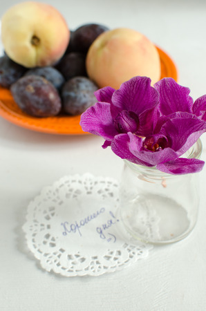 purple leaf plum: composition from orchids and fruit