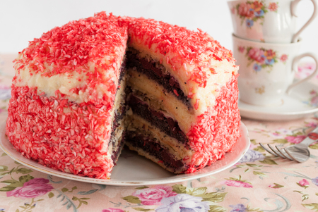 poppy seeds: Home layered cake with poppy seeds, cherries and nuts