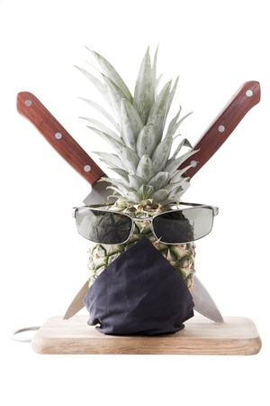 Ninja Pineapple in table with knifes on white background