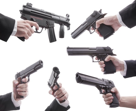 Lots of desert eagles and mp5k colt on white background Stock Photo