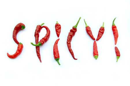 Cayenne Peppers form the word Spicy! Stock Photo
