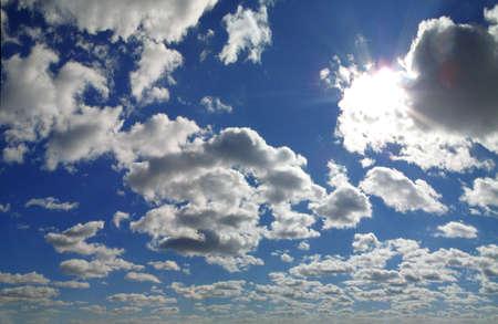Blue sky with cumulus clouds in contrast
