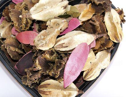 potpourri: Potpourri in a heart shaped bowl.