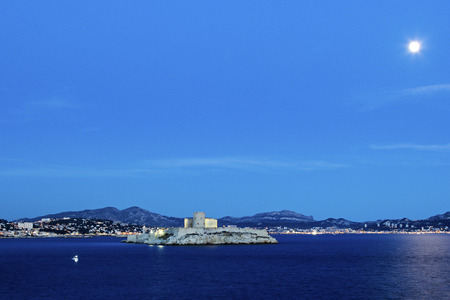 ancient prison: View on Marseilles city and Castle of If in France in the evening Editorial