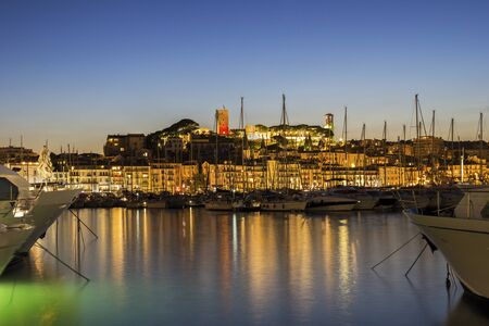 water town: View on the harbor in Cannes on French Riviera in the evening Stock Photo
