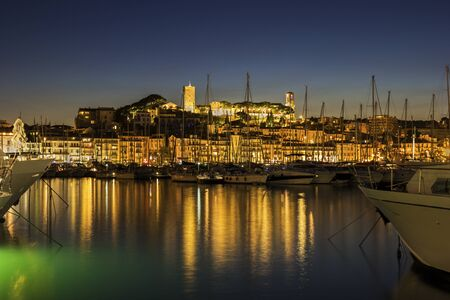 french riviera: View on the harbor in Cannes on French Riviera in the evening Stock Photo