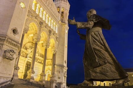 re design: Basilica of Notre-Dame and Pope John Paul II statue in Lyon, France