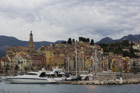 menton: Harbor of Menton with the basilica of Saint-Michel-Archange in the background Editorial