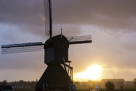 holland windmill: Windmill in Kinderdijk in Holland at sunset