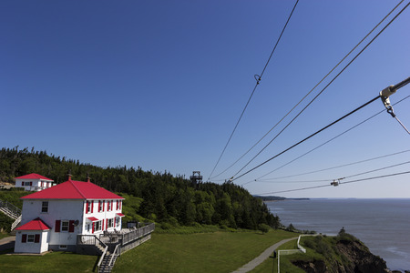 enrage: Zip line at Cape Enrage in New Brunswick in Canada Editorial