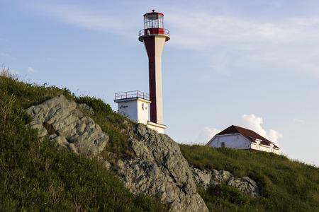 scotia: Cape Forchu Lighthouse in Nova Scotia in Canada Stock Photo