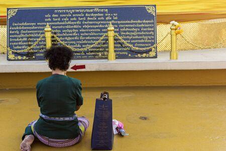 worshipper: Praying woman in front of Wat Saket in Bangkok in Thailand,