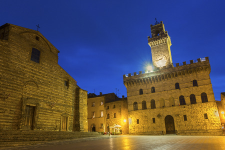 montepulciano: The Cathedral of Santa Maria Assunta and Communal Palace in Montepulciano in Italy in the evening