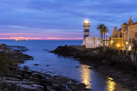 portugal: Santa Maria Lighthouse in Cascais in Portugal in the morning