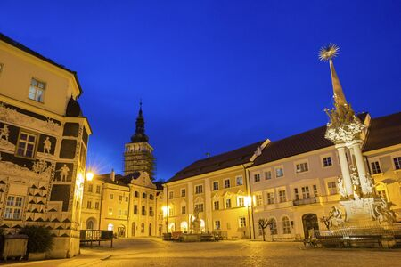 allegoric: Historic Square with Holy Trinity Statue and Church of St. Wenceslas in the background in Mikulov in Czech Republic Editorial