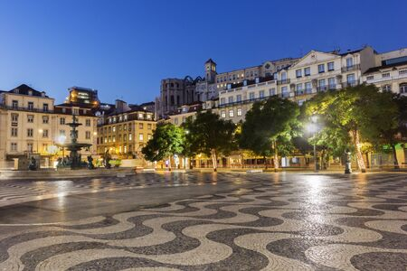 carmo: Rossio Square with Carmo Convent in the background in Lisbon in Portugal in the morning Stock Photo