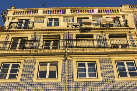decorative balconies: Building decorated with traditional azulejo in Lisbon in Portugal