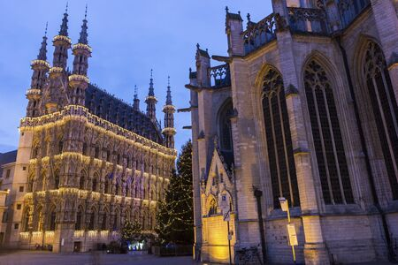 leuven: Magnificent City Hall of Leuven and St. Peters Church in Belgium during Christmas Stock Photo