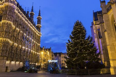 and magnificent: Magnificent City Hall of Leuven and St. Peters Church in Belgium during Christmas Stock Photo