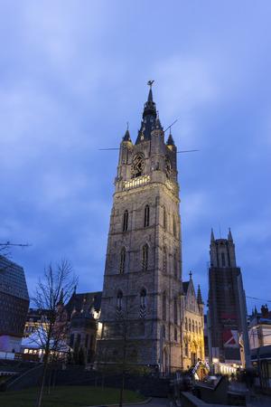 belfry: Belfry of Ghent in Belgium in the evening Stock Photo